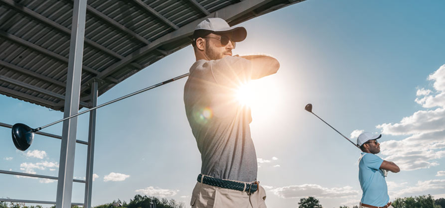 golfers practicing at driving range